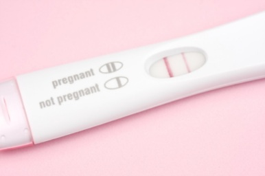 Close-up of a positive pregnancy test.  Shallow depth of field.